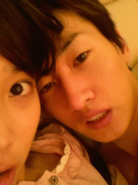 IU Accidentally Tweets Photo In Bed Together With Super Junior's Eunhyuk