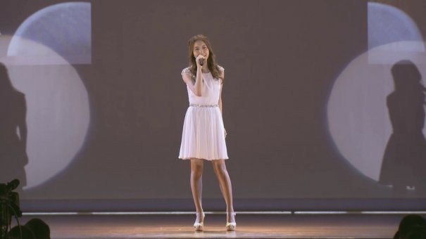 May J Surprises With Performance At A High School Graduation Ceremony